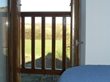 View across fields from single bed in Bedroom 1